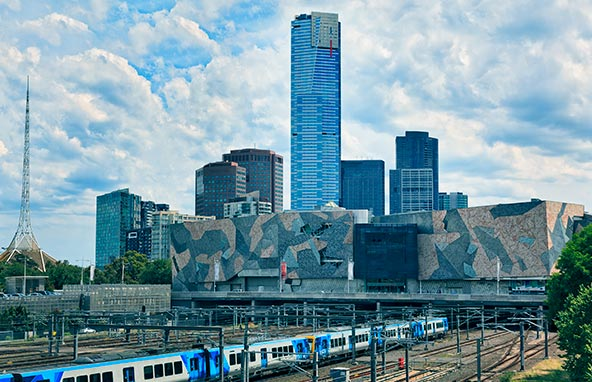 Infraco image of Melbourne with a train near Federation square